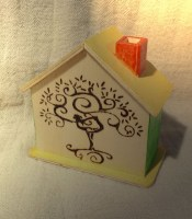 Money box in shape of a house.